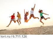 Купить «smiling friends dancing and jumping on beach», фото № 6711126, снято 3 августа 2014 г. (c) Syda Productions / Фотобанк Лори