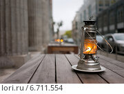 Купить «Berlin, Germany, kerosene lamps on an empty wooden tables», фото № 6711554, снято 19 мая 2010 г. (c) Caro Photoagency / Фотобанк Лори
