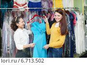 Купить «women chooses evening gown», фото № 6713502, снято 19 декабря 2012 г. (c) Яков Филимонов / Фотобанк Лори