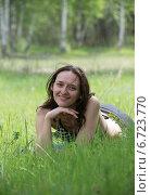 Купить «Девушка на лесной поляне», фото № 6723770, снято 10 мая 2014 г. (c) Yanchenko / Фотобанк Лори