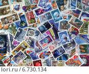 Купить «Фон из почтовых марок СССР, объединенных темой Освоение космоса», эксклюзивная иллюстрация № 6730134 (c) Иван Марчук / Фотобанк Лори