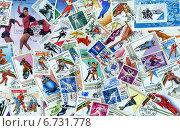 Купить «Фон из почтовых марок разных стран (XX в.) на тему зимних видов спорта», эксклюзивное фото № 6731778, снято 22 ноября 2019 г. (c) Иван Марчук / Фотобанк Лори