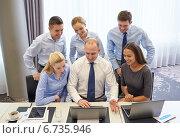 Купить «smiling business people with laptop in office», фото № 6735946, снято 25 октября 2014 г. (c) Syda Productions / Фотобанк Лори