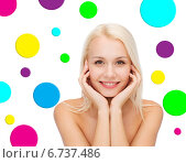 Купить «beautiful young woman over polka dot background», фото № 6737486, снято 15 апреля 2014 г. (c) Syda Productions / Фотобанк Лори