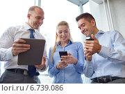 Купить «business people with tablet pc and smartphones», фото № 6739086, снято 25 октября 2014 г. (c) Syda Productions / Фотобанк Лори