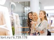 Купить «happy young women with shopping bags in mall», фото № 6739178, снято 3 ноября 2014 г. (c) Syda Productions / Фотобанк Лори