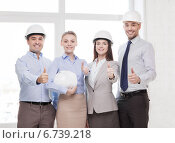 Купить «happy business team in office showing thumbs up», фото № 6739218, снято 5 апреля 2014 г. (c) Syda Productions / Фотобанк Лори