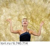 Купить «smiling woman raising hands and looking up», фото № 6740714, снято 1 июня 2014 г. (c) Syda Productions / Фотобанк Лори