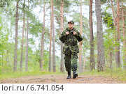 Купить «young soldier with backpack in forest», фото № 6741054, снято 14 августа 2014 г. (c) Syda Productions / Фотобанк Лори