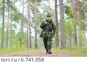 young soldier or hunter with gun in forest. Стоковое фото, фотограф Syda Productions / Фотобанк Лори