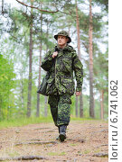 Купить «young soldier or hunter with gun in forest», фото № 6741062, снято 14 августа 2014 г. (c) Syda Productions / Фотобанк Лори
