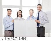 Купить «business team in office with white blank board», фото № 6742498, снято 5 апреля 2014 г. (c) Syda Productions / Фотобанк Лори