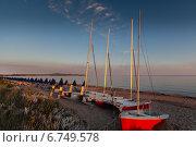 Купить «Пляж рано утром, яхты на песке», фото № 6749578, снято 12 июня 2012 г. (c) Anna P. / Фотобанк Лори