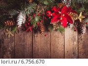 Купить «Рождественская композиция с елочными украшениями, еловыми ветками и шишками на деревянном фоне», фото № 6756670, снято 23 ноября 2012 г. (c) Оксана Ковач / Фотобанк Лори