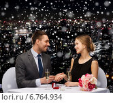Купить «smiling couple with red gift box at restaurant», фото № 6764934, снято 9 марта 2014 г. (c) Syda Productions / Фотобанк Лори