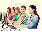 Купить «smiling student with computer studying at school», фото № 6764986, снято 4 мая 2014 г. (c) Syda Productions / Фотобанк Лори