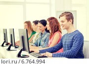 Купить «male student with classmates in computer class», фото № 6764994, снято 4 мая 2014 г. (c) Syda Productions / Фотобанк Лори