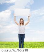 Купить «smiling little girl holding blank white board», фото № 6765218, снято 9 апреля 2014 г. (c) Syda Productions / Фотобанк Лори