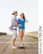 Купить «smiling couple with skateboard outdoors», фото № 6765254, снято 7 июля 2014 г. (c) Syda Productions / Фотобанк Лори