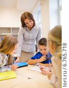 Купить «group of school kids writing test in classroom», фото № 6765718, снято 15 ноября 2014 г. (c) Syda Productions / Фотобанк Лори