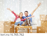 Купить «smiling couple relaxing and waving hand at home», фото № 6765762, снято 26 января 2014 г. (c) Syda Productions / Фотобанк Лори