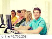 Купить «male student with classmates in computer class», фото № 6766202, снято 29 марта 2014 г. (c) Syda Productions / Фотобанк Лори