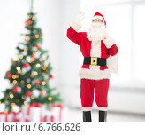 Купить «man in costume of santa claus with bag», фото № 6766626, снято 10 сентября 2014 г. (c) Syda Productions / Фотобанк Лори