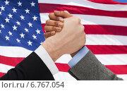 Купить «close up of hands arm wrestling over american flag», фото № 6767054, снято 12 декабря 2013 г. (c) Syda Productions / Фотобанк Лори