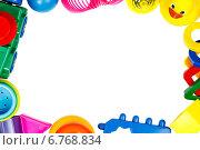 Купить «Рамка из детских игрушек. Место для текста», фото № 6768834, снято 16 ноября 2014 г. (c) Йомка / Фотобанк Лори