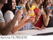 Купить «Happy friends having a drink together», фото № 6783610, снято 27 июня 2014 г. (c) Wavebreak Media / Фотобанк Лори