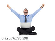 Купить «Businessman sitting on the floor cheering», фото № 6785598, снято 25 июня 2014 г. (c) Wavebreak Media / Фотобанк Лори