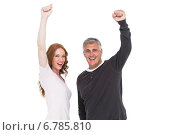 Купить «Casual couple cheering at camera», фото № 6785810, снято 25 июня 2014 г. (c) Wavebreak Media / Фотобанк Лори