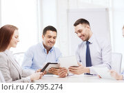 Купить «business team working with tablet pc in office», фото № 6795274, снято 5 апреля 2014 г. (c) Syda Productions / Фотобанк Лори
