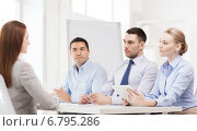 Купить «business team interviewing applicant in office», фото № 6795286, снято 5 апреля 2014 г. (c) Syda Productions / Фотобанк Лори