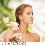 Купить «beautiful young woman with orchid flowers», фото № 6795450, снято 16 сентября 2012 г. (c) Syda Productions / Фотобанк Лори