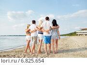 Купить «smiling friends hugging and walking on beach», фото № 6825654, снято 24 мая 2020 г. (c) Syda Productions / Фотобанк Лори