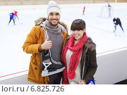 Купить «happy couple with ice-skates on skating rink», фото № 6825726, снято 26 ноября 2014 г. (c) Syda Productions / Фотобанк Лори