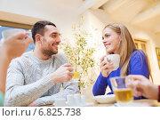 Купить «happy couple meeting and drinking tea or coffee», фото № 6825738, снято 26 ноября 2014 г. (c) Syda Productions / Фотобанк Лори
