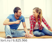 Купить «smiling couple measuring wood flooring», фото № 6825966, снято 26 января 2014 г. (c) Syda Productions / Фотобанк Лори