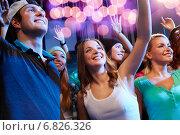 Купить «smiling friends at concert in club», фото № 6826326, снято 20 октября 2014 г. (c) Syda Productions / Фотобанк Лори