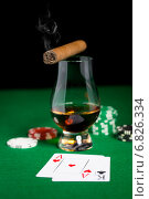 Купить «close up of chips, cards whisky and cigar on table», фото № 6826334, снято 17 октября 2014 г. (c) Syda Productions / Фотобанк Лори