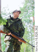 Купить «young soldier or hunter with gun in forest», фото № 6826362, снято 14 августа 2014 г. (c) Syda Productions / Фотобанк Лори