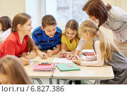 Купить «group of school kids writing test in classroom», фото № 6827386, снято 15 ноября 2014 г. (c) Syda Productions / Фотобанк Лори