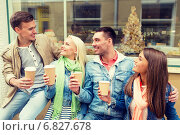 Купить «group of smiling friends with take away coffee», фото № 6827678, снято 14 июня 2014 г. (c) Syda Productions / Фотобанк Лори