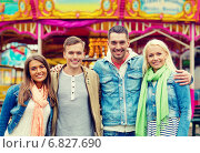 Купить «group of smiling friends in amusement park», фото № 6827690, снято 14 июня 2014 г. (c) Syda Productions / Фотобанк Лори