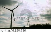 Купить «Windmill spinning against a grey sky», видеоролик № 6830786, снято 15 октября 2019 г. (c) Wavebreak Media / Фотобанк Лори