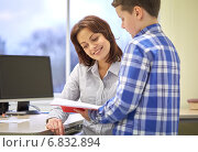 Купить «school boy with notebook and teacher in classroom», фото № 6832894, снято 15 ноября 2014 г. (c) Syda Productions / Фотобанк Лори