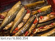 Купить «Копченая фаршированная скумбрия на рижском рынке», фото № 6860354, снято 21 августа 2014 г. (c) Gagara / Фотобанк Лори