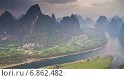 Купить «Карстовые холмы и река, Китай, таймлапс», видеоролик № 6862482, снято 5 августа 2014 г. (c) Кирилл Трифонов / Фотобанк Лори