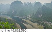 Купить «Карстовые холмы и река, Китай, таймлапс», видеоролик № 6862590, снято 3 августа 2014 г. (c) Кирилл Трифонов / Фотобанк Лори